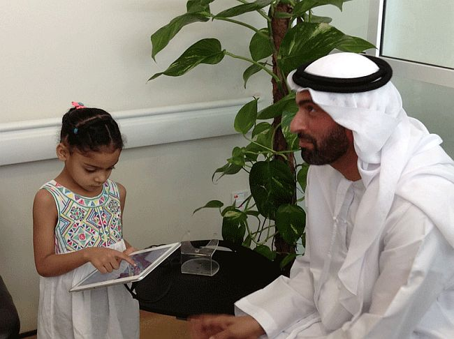 DHA Director General watches child with Android Tablet